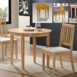 round wooden drop leaf dining table for small spaces with two comfy seats or chairs plus soft rug on wooden floor plus dining set