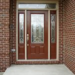 screen door with decorative glass panel and sidelights feature
