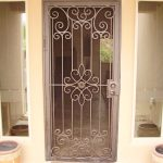 screen door with security panel made from crafted metal