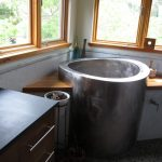 silver deep tubs for small bathrooms in japanese style and glass windows and natural floor and vanity units