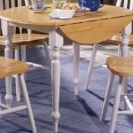 simple and round wooden drop leaf dining table for small spaces combined with wooden chairs plus blue rug area on wooden flooring