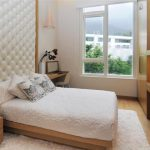 simple bed furniture with full length headboard built in closet and shelf small corner table with chair pure white rug for wood floors