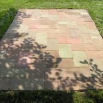 simple fabricated reddish brick flooring over concrete design in the middle of grassy meadow