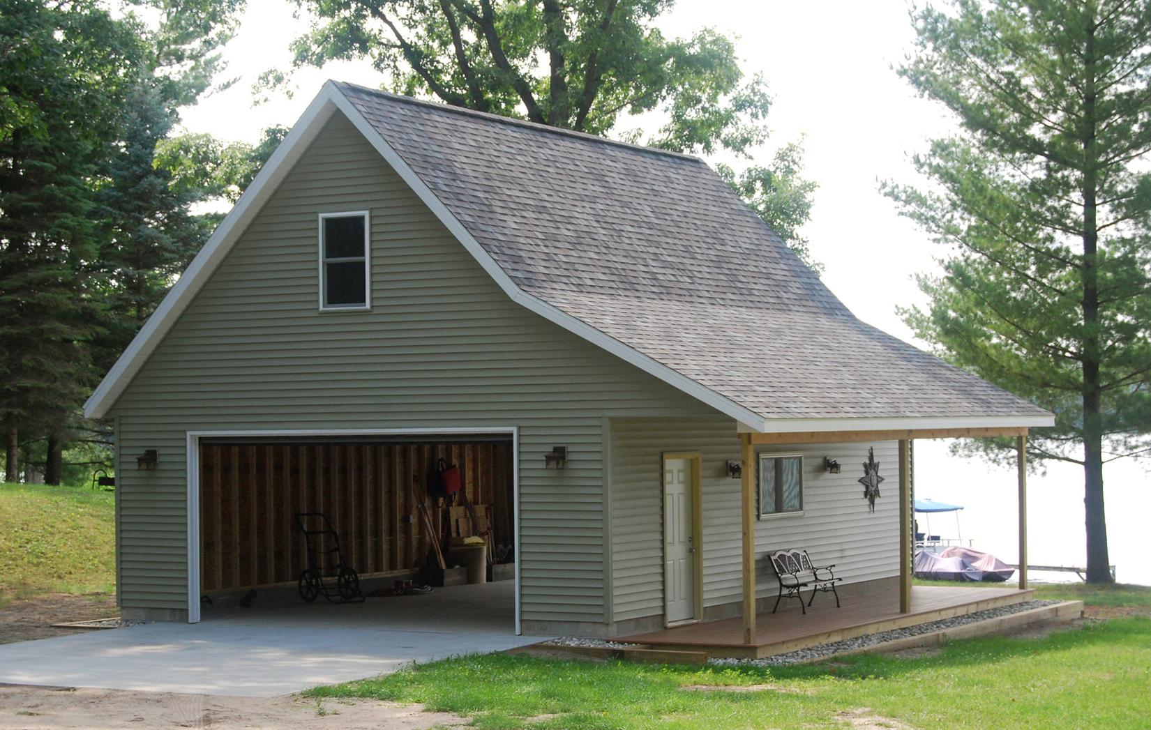 Pole barn house pictures that show classic construction for Barns and garages