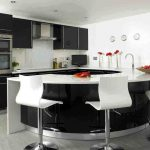 simple  kitchen design with half round kitchen island with sink and faucet plus white barstools white countertop with white tiles backsplash black painted cabinets modern kitchen utensils
