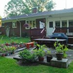 simple landscape idea by Better Homes and Gardens with mini garden small front deck