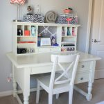 simple white wooden student desk design with conventional chair with storage design and orange chevron patterned table lamp upon gray floor