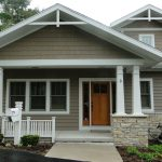 small and simple front porch idea for simple ranch home construction little white paint wood railings for porch and larger concrete pillars in white tone paint color