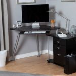 Small Corner Ike Desk Design With Metal Legs And Cone Countertop With Black Armoire Aside And Robotic Table Lamp