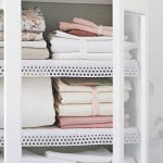 small lovely modern linen closet organizer with white framed sliding glass door and net white board
