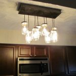 sophisticated mason jar lighting fixtures for kitchen on white ceiling and built in oven