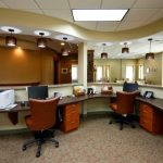 spacious office design with u shaped desk design beneath wonderful ceiling idea with modern lighting