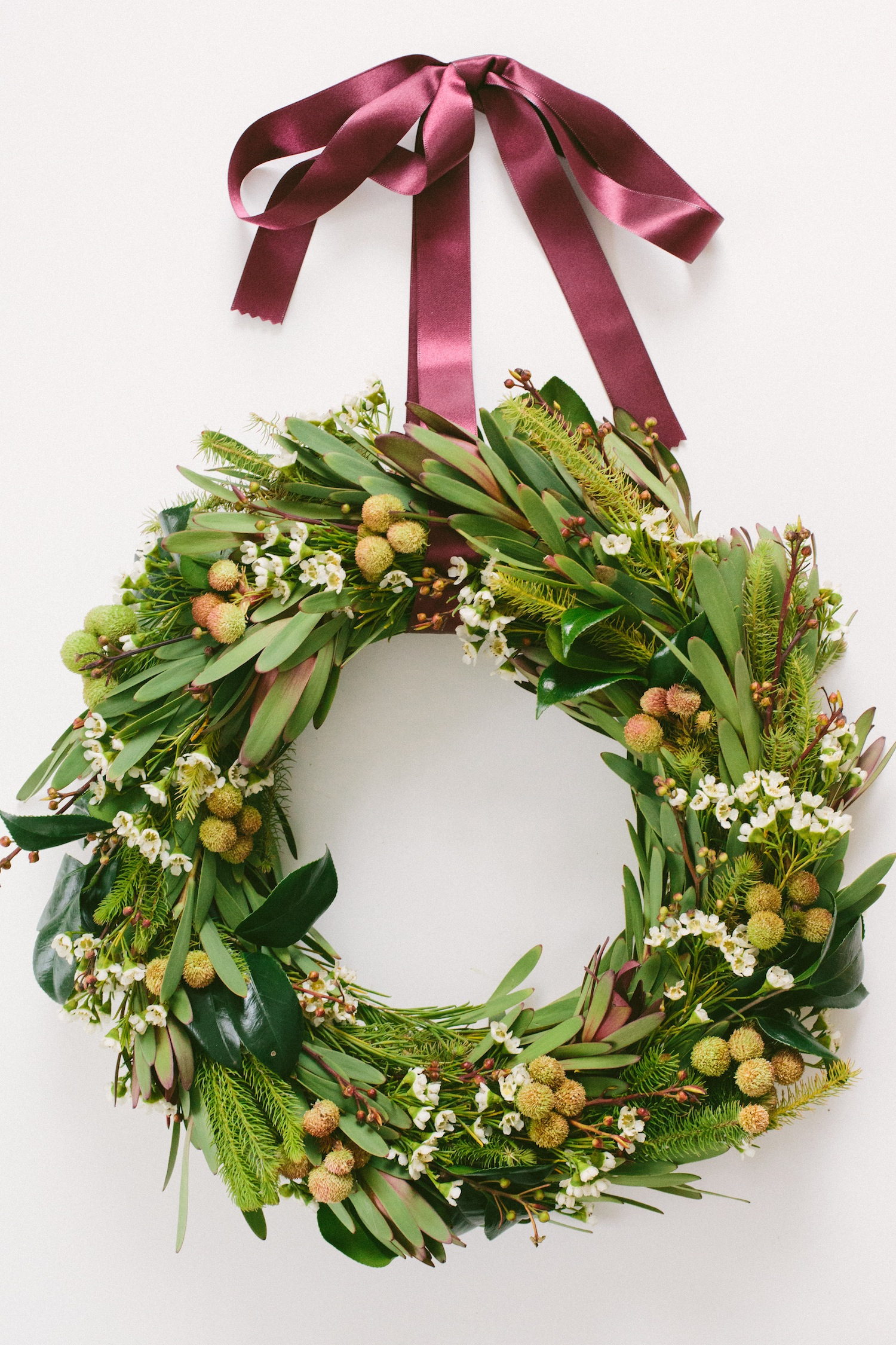 spring holiday wreath with green leaf and flowers plus purple ribbon diy. the most beautiful pottery barn ...