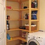 standing natural wooden racks idea in laundry room with washer and dryer design in cream room