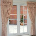stunning pink lace curtain design for french door with white framed glass style with bronze rod idea