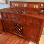 stunning wooden sideboard with wine bottle storage and drawers decorated next to comfy seating and rug on floor