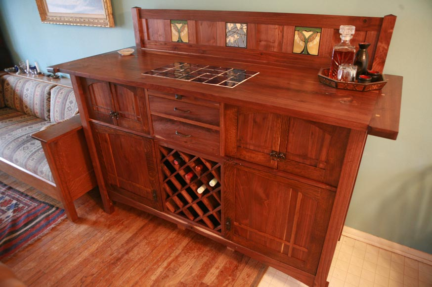 Stunning Wooden Sideboard With Wine Bottle Storage And Drawers Decorated Next To Comfy Seating Rug