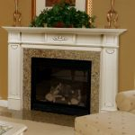 tall fireplace mantel height with white wooden mantel and granite greenery on top plus golden candleholders and framed picture on wall decoration plus comfy sofa