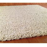 thick and soft wool carpet in light brown tone color for wood planks floors
