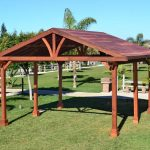traditional outdoor pavilion plans at the backyard with green grass yard and pathways garden ideas