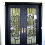 two panels security door in black frame and crafted glass screen