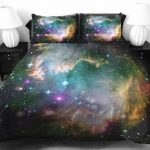 unique fun bed sheet design of galaxy of the outerspace in beautiful color with the same tone pillows between two white table lamps