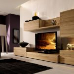 unique wooden tv consoles in living room with wall mounted and storage and artistic display plus rug and sofa and standing lamp