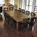 vintage wooden long and large dining table design for 12 people with wooden table and chairs with unique backrest and wooden floor and open plan
