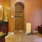 walk in showers no doors with tile for wall and tile for bathroom flooring plus wooden vanity units combined with mirror and wall scones