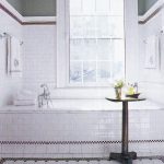 white bathroom ideas with subway tile sizes on wall and floor completed with glass windows and round bathroom table