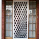 white crafted metal screen door with  larger sidelights