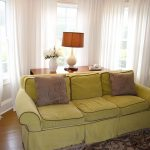 white curtain window treatments for wide windows combined with yellow sofa and brown cushions plus modern rug and wooden floor plus table lamp