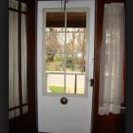 white wood screen door with glass screen and single sidelight