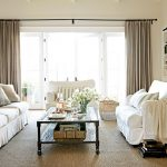 window coverings for large windows with beige curtain in stunning living room with white fabric sofa and cushions plus classic coffee table and jute rug