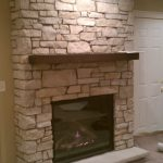 wood burned fireplace mantel made from Fond du lac stones
