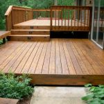 Wooden Deck Floor Design With Woodenfence Idea And Staircase With Wooden Bench And Simple Porch Skirting And Greenery Aside Lush Vegetation
