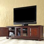 wooden low profile media console TV stand in traditional style combined with media storage plus moren rug floor area and soft wall paint home furniture ideas