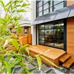 zero energy home idea with solar panels on porch's roof wood dominant wall and floor plans