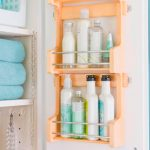 A closet with orange bottles containers the series of kits for organizing the accessories a shelf for linens
