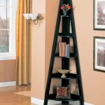 Attractive corner bookshelves in black color as the corner decoration