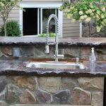 Attractive outdoor kitchen countertop with sink and faucet