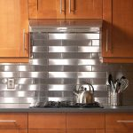 Backsplash tiles idea made from stainless steel small gas stove appliance stainless steel container for spoons and forks electrical cord wooden kitchen cabinet system
