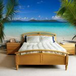 Beautiful beach bedroom idea with simple wooden bed furniture white bedding and white pillows wooden bedside tables beach picture on wall