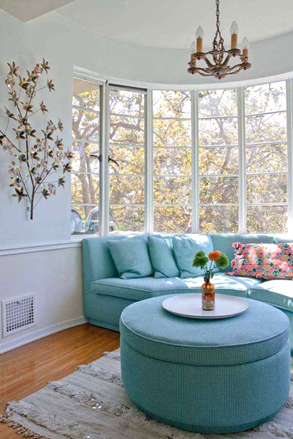 Beautiful Curved Sofa With Blue Pillows And Ottoman Table As Bay Window Furniture Small Sized