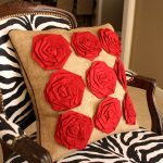Beautiful Throw Pillow In Big Size With Red Textured Flower Ornament In Its Brown Cover Monochrome Color Tone Chair