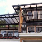 Blurred plastic cover for home deck  black metal rails for deck a series of patio furniture