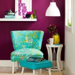 Bold purple wall color white pendant lamp turquoise reading chair with flower motifs turquoise table unique shaped white side table yellow pot and plant floating shelf