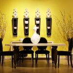 Bright Yellow Paint Idea For Classic Dining Furniture In Black Color Scheme A Medium Size White Decorative Vase Several Wall Decorations A Larger Console Table A Pair Of Pots With Their Artistic Plants