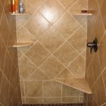 Brown ceramic tiles for shower space with some floating corner shelves