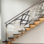 Brushed metal handrail with artistic shaped metal railing system